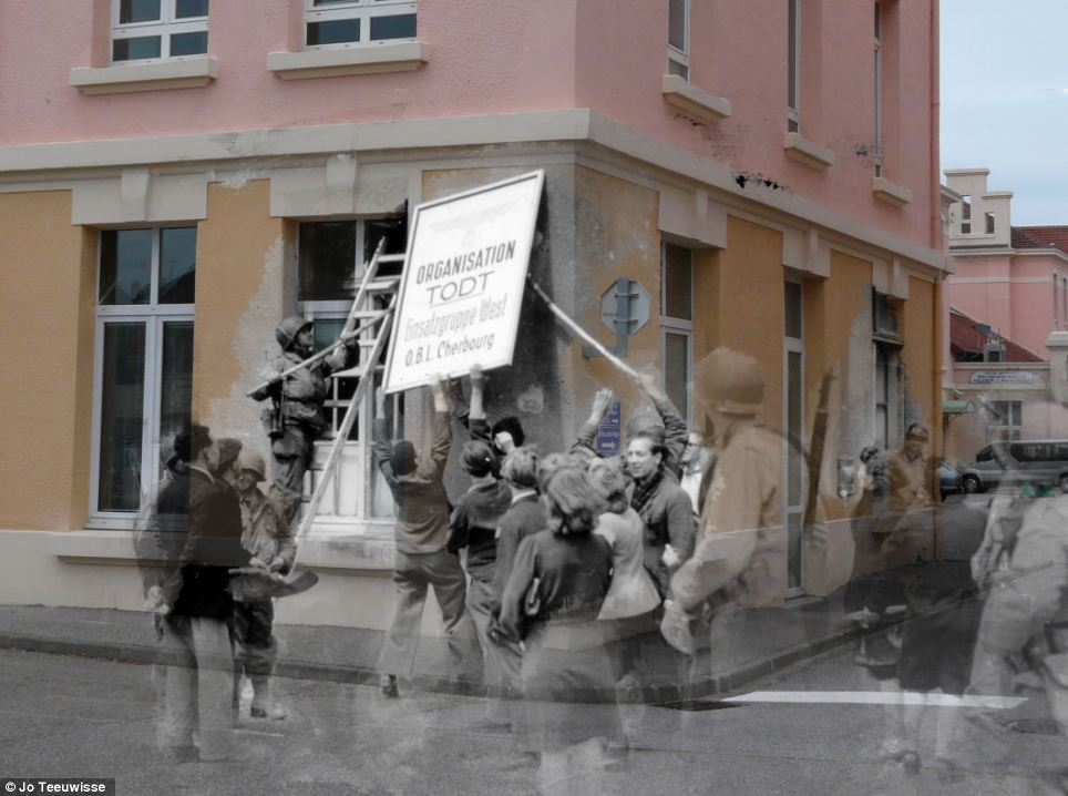 Historical colour: A sign reading Todt Organisation - a Third Reich civil and military engineering group in Germany - is pictured over a pretty orange and pink house