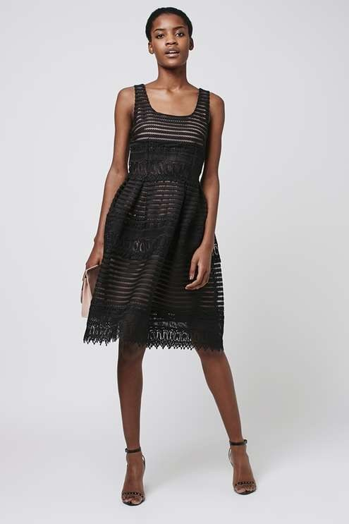 This textured nude-and-black dress they can wear again and again — $180